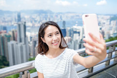 Woman taking selfie in Hong Kong Stock Images