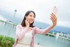 Woman taking selfie in Macau Royalty Free Stock Images