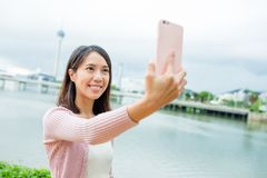 Woman taking selfie by mobile phone Stock Photo