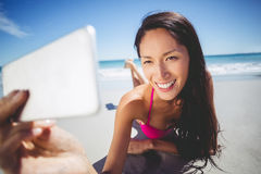 Woman taking selfie on mobile phone Stock Photo