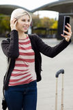 Woman Taking Selfie With Mobile Phone Outside Railroad Station Stock Image