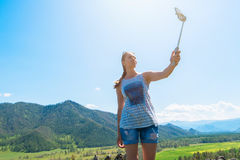Woman taking selfie on mobile phone Royalty Free Stock Photo