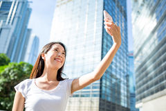 Woman taking selfie by mobile phone Stock Images