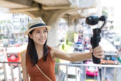 Woman taking selfie movie by video stabilizer Stock Image