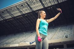 Woman taking selfie with phone camera. Modern social media concept Stock Photo