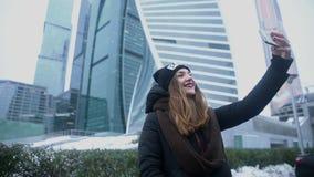 Woman taking selfie phone. Skyscraper stock footage