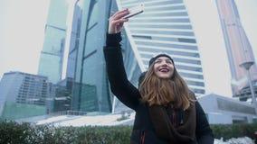 Woman taking selfie phone. Skyscraper stock video