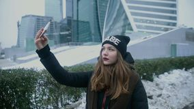 Woman taking selfie phone stock video footage