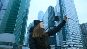 Woman taking selfie phone. Skyscraper stock video footage
