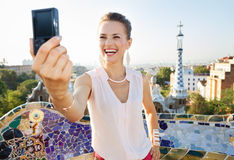 Woman taking selfie with photo camera in Park Guell, Spain Stock Images