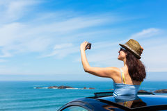 Woman taking selfie photo on car summer travel Royalty Free Stock Photos