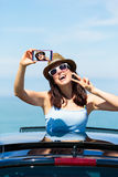 Woman taking selfie photo on car summer vacation Stock Images