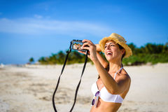 Woman taking selfie photo on tropical vacation Royalty Free Stock Images