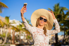 Woman taking selfie photo on vacation in tropical resort Stock Images