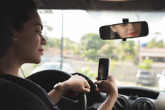 Woman taking selfie picture in the car Royalty Free Stock Image