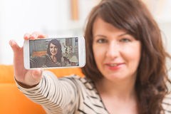 Woman taking selfie picture Royalty Free Stock Images