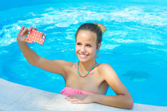 Woman taking selfie in the pool Stock Images
