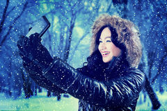 Woman taking a selfie portrait at park Royalty Free Stock Image