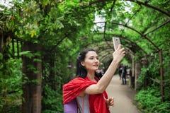 Woman taking selfie Stock Photo