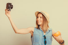 Woman taking selfie self picture with camera. Royalty Free Stock Images