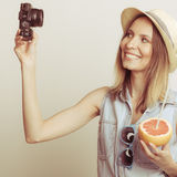 Woman taking selfie self picture with camera. Stock Photo
