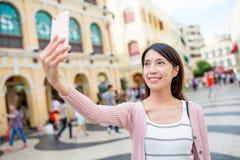 Woman taking selfie in Senado Square of Macao Royalty Free Stock Photos