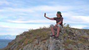 Woman taking selfie stock video