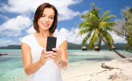 Woman taking selfie by smartphone on beach Stock Photo