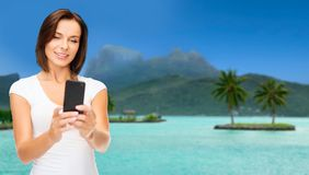 Woman taking selfie by smartphone on bora bora Stock Images