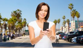 Woman taking selfie by smartphone in los angeles Stock Image