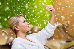 Woman taking selfie with smartphone  at spa Stock Photos