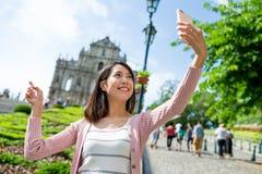 Woman taking selfie with St.Paul Church in macau Stock Image