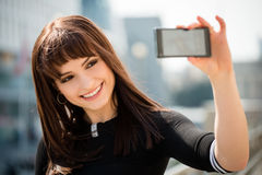 Woman taking selfie at street Royalty Free Stock Photo