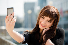 Woman taking selfie at street Stock Photography