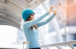 Woman taking selfie with travel bags during traveling Royalty Free Stock Photos