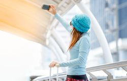 ]woman taking selfie with travel bags during traveling Royalty Free Stock Photography