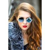 Woman Taking Selfie Wearing Round Blue Sunglasses royalty free stock photos