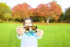 Woman taking selfie Stock Photography