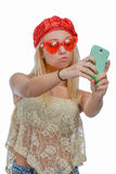 Woman taking selfie Stock Photography
