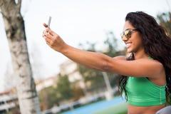 Woman taking selfies Stock Photo