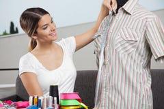 Woman Taking Shirt's Measurement Stock Photos