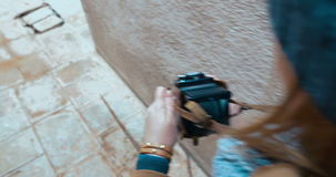 Woman taking shots with retro camera outdoor stock video