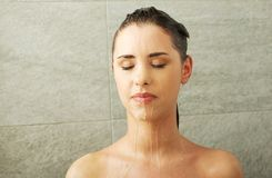 Woman taking shower Stock Photos