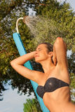 Woman taking a shower outdoors Royalty Free Stock Images