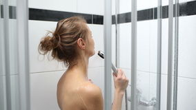 Woman taking a shower stock footage