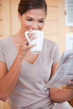 Woman taking a sip of coffee Stock Photos