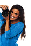 Woman taking a snap, smile please Royalty Free Stock Photos