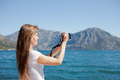 Woman taking snapshot Royalty Free Stock Photography
