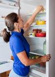 Woman taking something of the fridge Stock Image