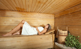 Woman is taking a steam-bath Royalty Free Stock Images